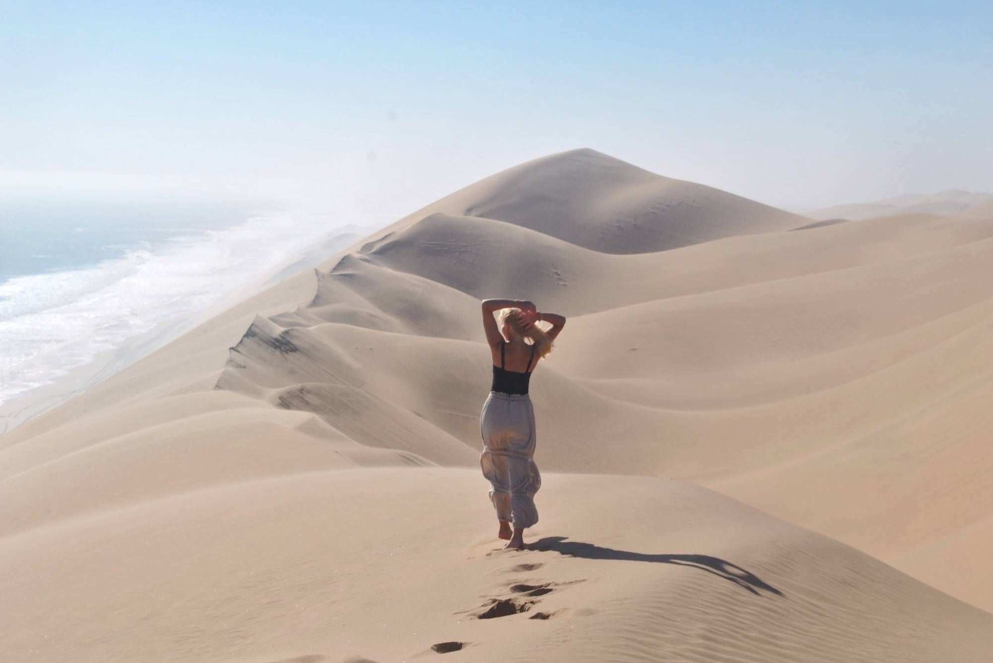 Student standing in the desert in Namibia, Africa